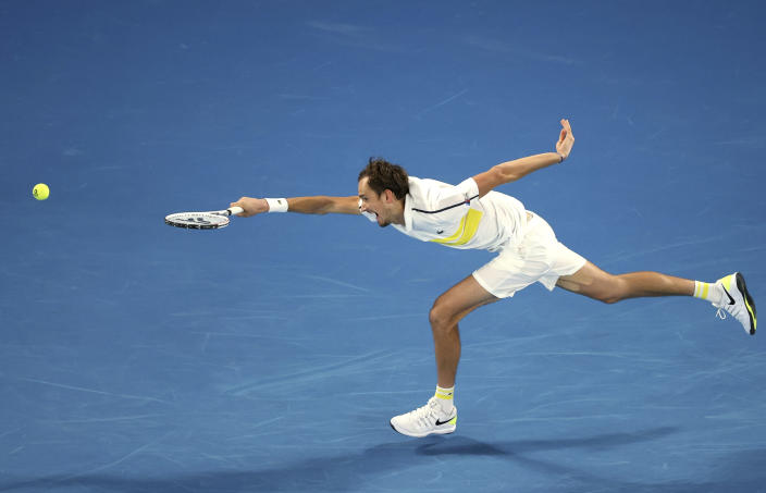 Russia's Daniil Medvedev can not reach the ball to hit a forehand to Serbia's Novak Djokovic during the men's singles final at the Australian Open tennis championship in Melbourne, Australia, Sunday, Feb. 21, 2021. (AP Photo/Hamish Blair)