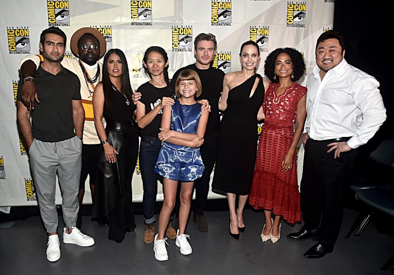Kumail Nanjiani, Brian Tyree Henry, Salma Hayek, director Chloe Zhao, Lia McHugh, Richard Madden, Angelina Jolie, Lauren Ridloff and Don Lee of The Eternals. (Photo: Alberto E. Rodriguez/Getty Images for Disney)