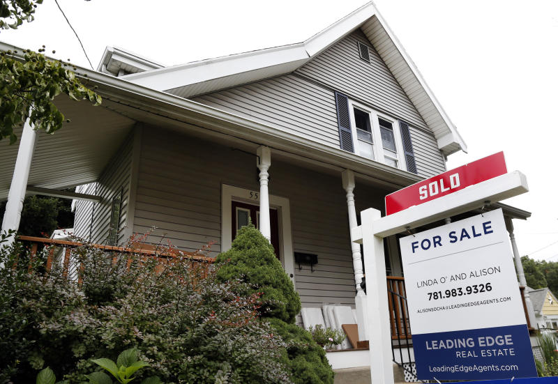 FILE- In this Aug. 21, 2018, file photo, a home has been sold sign in Melrose, Mass. On Thursday, Nov. 29, Freddie Mac reports on the week's average U.S. mortgage rates. (AP Photo/Elise Amendola, File)
