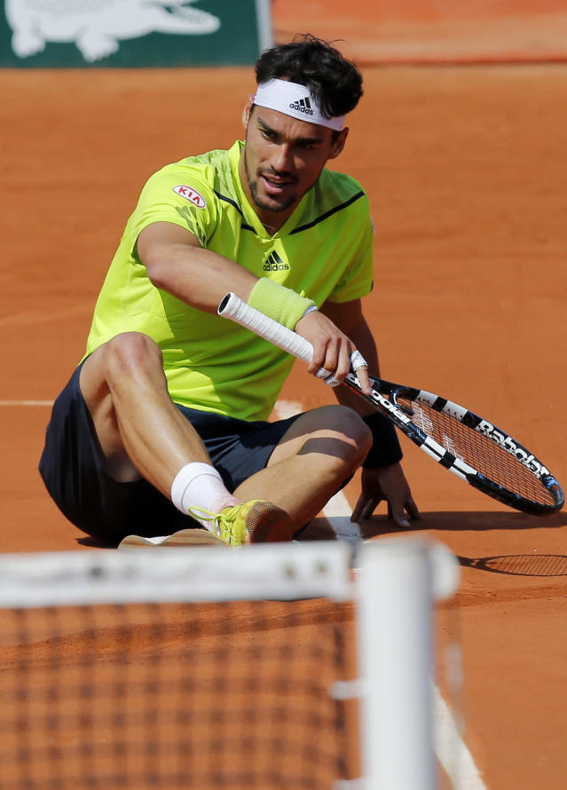 Italy's Fabio Fognini sits after falling as he plays France's Gael Monfils in their third round match of the French Open tennis tournament at the Roland Garros stadium, in Paris, France, Saturday, May 31, 2014. (AP Photo/David Vincent)