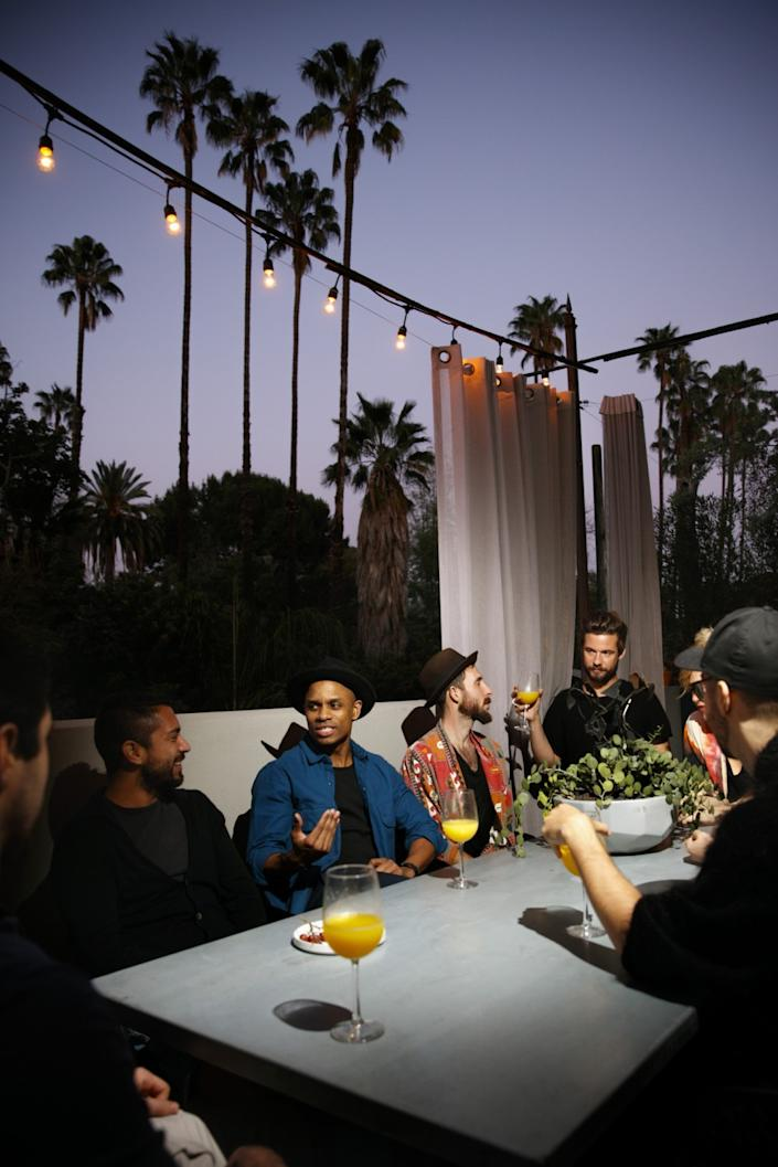 "Matty Pipes and friends enjoy the outdoors beneath a simple string of lights in Hollywood. <span class=""copyright"">(Jay L. Clendenin / Los Angeles Times)</span>"