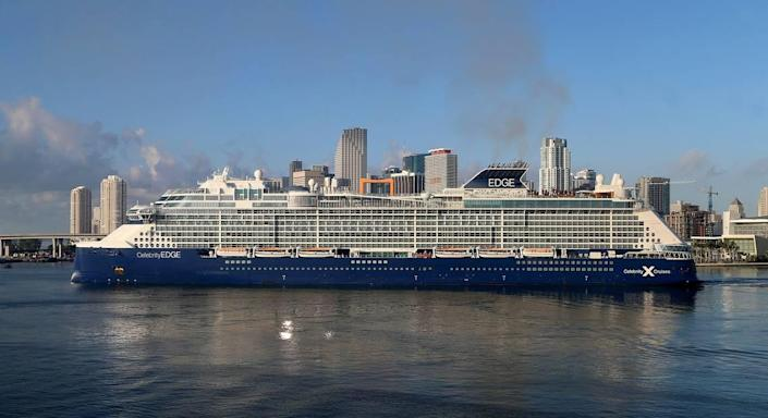 Celebrity Edge cruise ship blocks the view of the Miami skyline while arriving at PortMiami in the early morning on Thursday August 6, 2020.