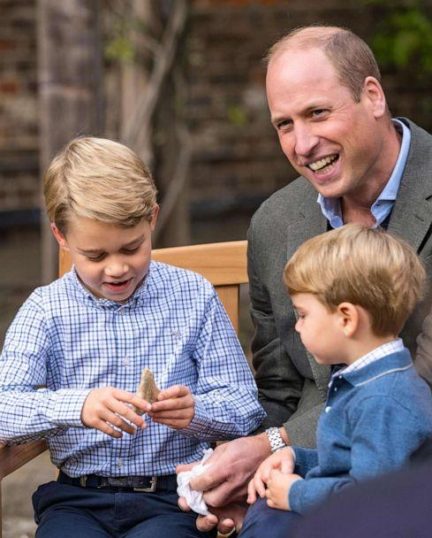 PHOTO: Prince William, Duke of Cambridge with his sons, Prince Louis and Prince George who is holding a tooth of a giant shark given to him by Sir David Attenborough in the gardens of Kensington Palace in London. (Kensington Palace/AFP via Getty Images)