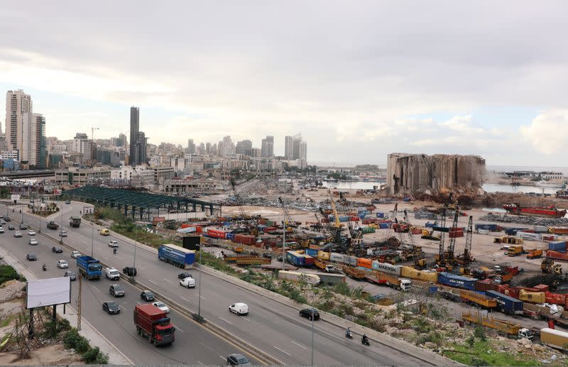 FILE PHOTO: Vehicles drive near the site of the Aug. 4 explosion at Beirut port, in Beirut
