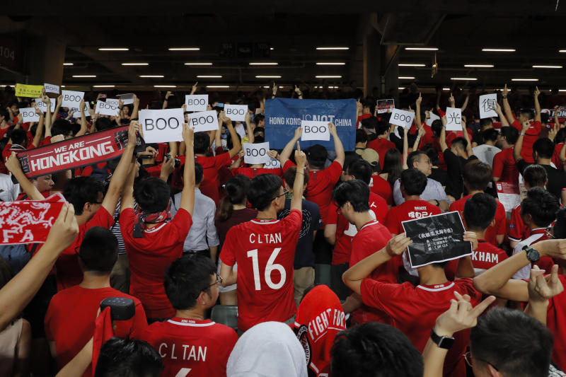 "Hong Kong soccer fans turn their back and boo the Chinese national anthem as they chant ""Hong Kong is not China"" during the FIFA World Cup Qatar 2022 and AFC Asian Cup 2023 Preliminary Joint Qualification Round 2 soccer match between Hong Kong and Iran, in Hong Kong, Tuesday, Sept. 10, 2019. The crowd broke out into ""Glory to Hong Kong,"" a song reflecting their campaign for more democratic freedoms in the semi-autonomous Chinese territory. (AP Photo/Kin Cheung)"