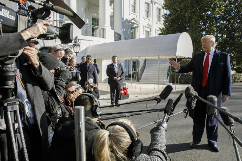President Donald Trump speaks to the media as he leaves the White House before departing to India, Sunday, Feb. 23, 2020, in Washington. (AP Photo/Jacquelyn Martin)