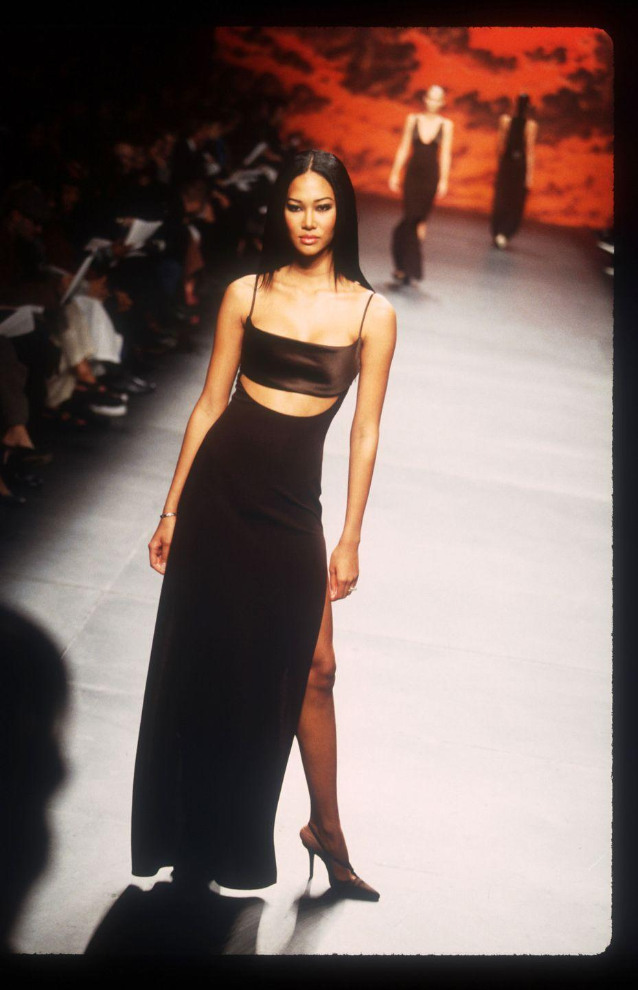 """<p>At the tender age of 13, Simmons was signed by Karl Lagerfeld at Chanel, who regarded her as the """"Face of the 21st Century."""" Brands like Fendi, Valentino, and Yves Saint Laurent also took notice. Then, after marrying entrepreneur Russell Simmons, she founded Baby Phat—eventually becoming the president of its parent company, Phat Farm, which amassed $265 million in profits in 2002. She also created the Kimora Lee Simmons Scholarship Fund and is involved in a number of charities. </p>"""