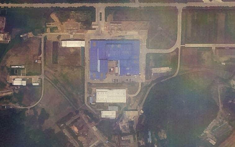 New satellite images show a red truck in a courtyard similar to previous vehicles used to help develop long range missiles