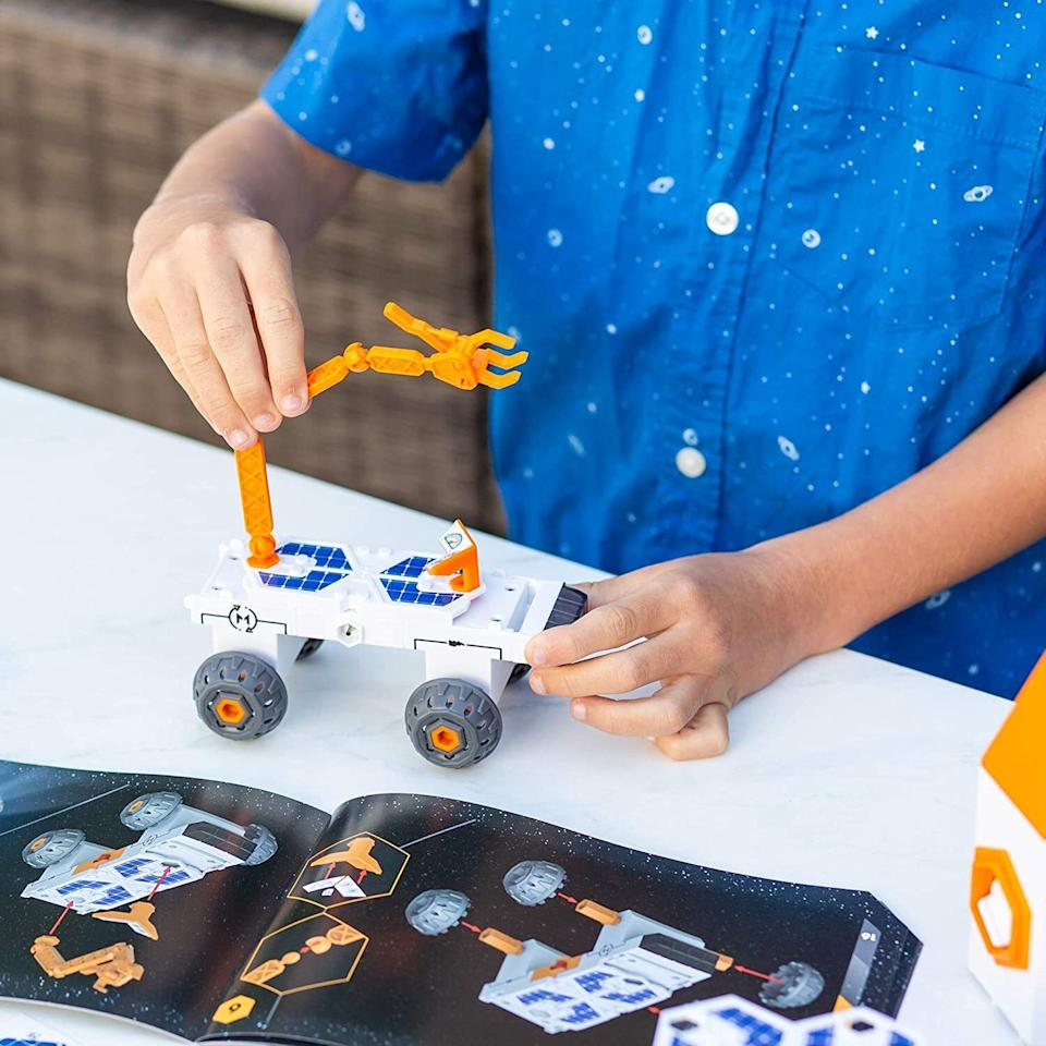 """Perfect forexploring the world of simple circuitry through buildable space-based vehicles and playsets. If your kid shows any interest in engineering or NASA, then this is a must-get toy for them.<br /><br /><strong>Get it from Amazon for <a href=""""https://www.amazon.com/dp/B08BXPR362?tag=huffpost-bfsyndication-20&ascsubtag=5764152%2C30%2C40%2Cd%2C0%2C0%2C0%2C962%3A1%3B901%3A2%3B900%3A2%3B974%3A3%3B975%3A2%3B982%3A2%2C15993563%2C0"""" target=""""_blank"""" rel=""""noopener noreferrer"""">$31.18</a>.</strong>"""