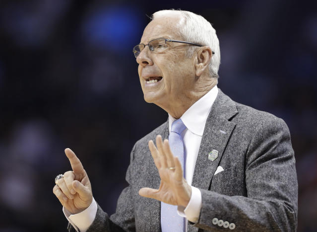 North Carolina head coach Roy Williams directs his team against Texas A&M during the first half of a second-round game in the NCAA men's college basketball tournament in Charlotte, N.C., Sunday, March 18, 2018. (AP Photo/Gerry Broome)
