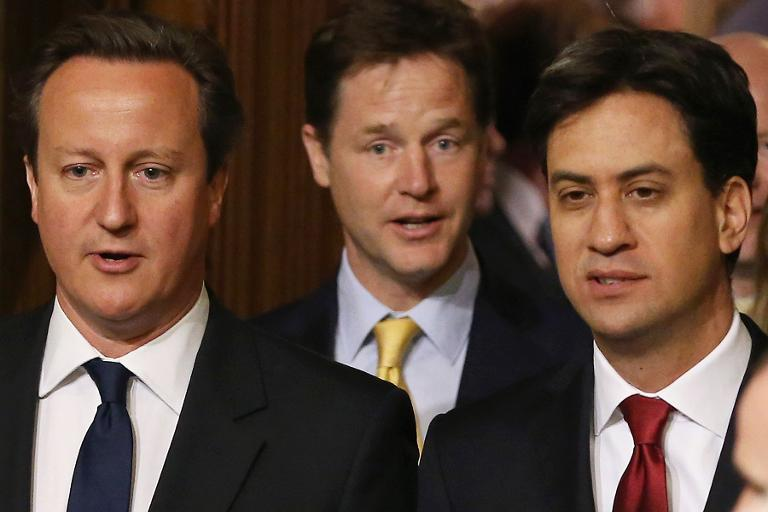 A file picture taken on June 4, 2014, shows British Prime Minister David Cameron (L) and leader of the opposition Labour Party Ed Miliband (R) and British Deputy Prime Minister Nick Clegg (C) during the State Opening of Parliament in London