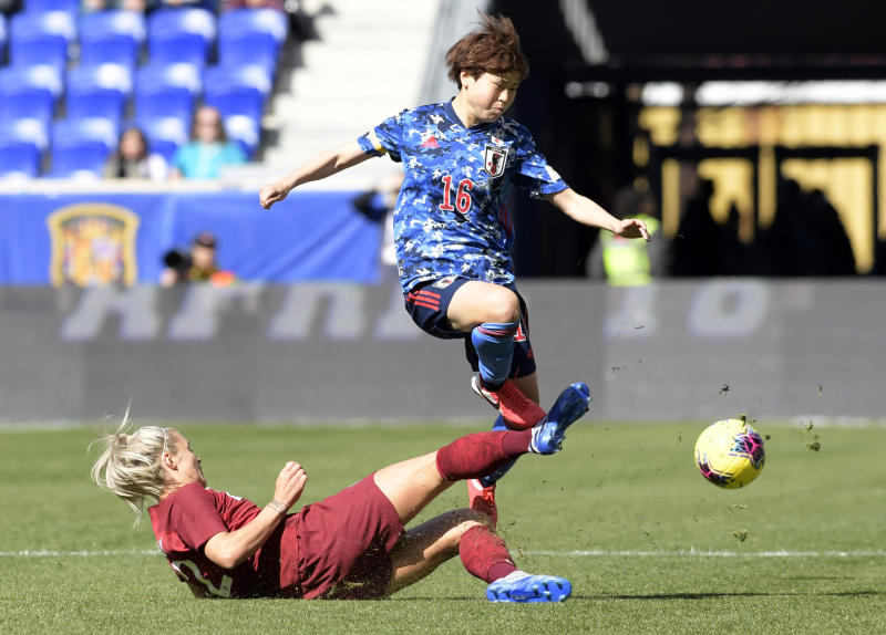 England defender Rachel Daly (2) tackles Japan defender Asato Miyagawa (16) during the first half of a SheBelieves Cup soccer match Sunday, March 8, 2020, in Harrison, N.J. (AP Photo/Bill Kostroun)