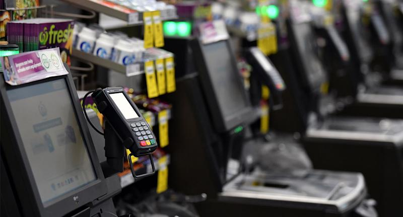 Checkouts pictured as shoppers are warned about the Rewards program at Woolworths.
