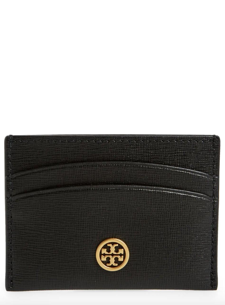 <p>Go above and beyond by surprising them with this luxe <span>Tory Burch Robinson Leather Card Case</span> ($68). The chic wallet will always be in style.</p>