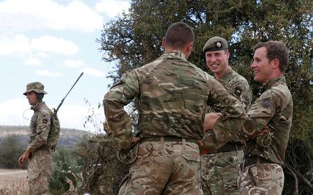 The Duke of Cambridge, Prince William talks to Major Ben Irwin-Clark, Company Commander, Number Two Company during his visit to the 1st Battalion the Irish Guards Battle group, training under the British Army Training Unit Kenya (BATUK), in his role as Colonel of the Regiment in Laikipia, Kenya September 30, 2018. REUTERS/Thomas Mukoya