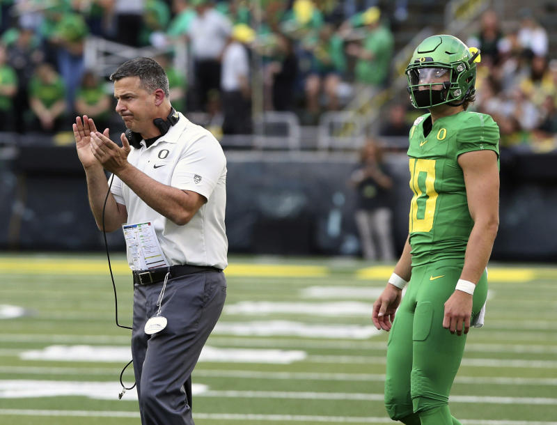 Herbert throws 5 TDs and No  16 Oregon routs Nevada 77-6