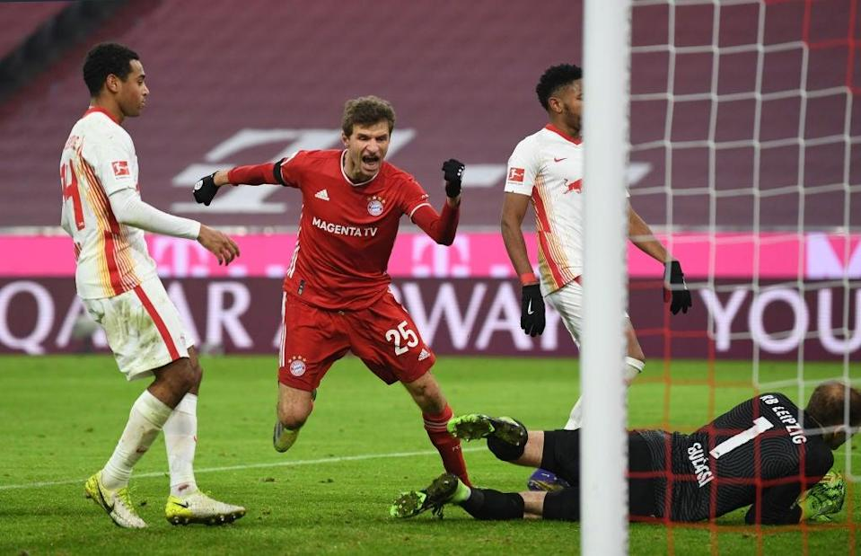 <p>Bayern Munich's Kingsley Coman in action with RB Leipzig's Nordi Mukiele</p> (Getty)