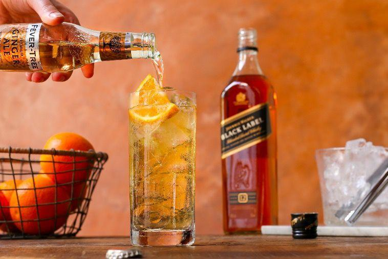 """<p>Fill a highball glass with ice cubes, and pour in one part Johnnie Walker Black Label Whiskey to three parts <a href=""""https://urldefense.com/v3/__https://fever-tree.com/en_GB/products/ginger-ale__;!!Ivohdkk!xIrM8Ivi6D9h0-uGKOAUCkzV5WW-PvOXfHAb4mGrHy_1aOxoUpg73Wdr0RRJxXeLBHojTAXb4sSZnQ$"""" rel=""""nofollow noopener"""" target=""""_blank"""" data-ylk=""""slk:Fever-Tree Ginger Ale"""" class=""""link rapid-noclick-resp"""">Fever-Tree Ginger Ale</a>. Give a gentle stir and garnish with a fresh slice of orange.</p>"""