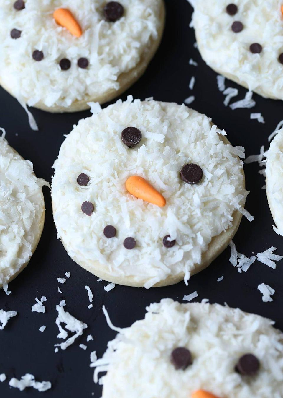 """<p>Frosty has never looked (or tasted!) this good. Enlist your little ones to help decorate the smiling faces.</p><p><strong>Get the recipe at <a href=""""https://cookiesandcups.com/coconut-snowman-cookies/"""" rel=""""nofollow noopener"""" target=""""_blank"""" data-ylk=""""slk:Cookies and Cups"""" class=""""link rapid-noclick-resp"""">Cookies and Cups</a>.</strong></p><p><strong><strong><a class=""""link rapid-noclick-resp"""" href=""""https://www.amazon.com/Nordic-Ware-Natural-Aluminum-Commercial/dp/B0049C2S32?tag=syn-yahoo-20&ascsubtag=%5Bartid%7C10050.g.647%5Bsrc%7Cyahoo-us"""" rel=""""nofollow noopener"""" target=""""_blank"""" data-ylk=""""slk:SHOP BAKING SHEETS"""">SHOP BAKING SHEETS</a></strong><br></strong></p>"""
