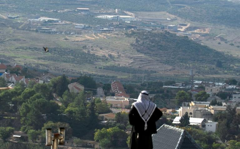 A Palestinian man looks towards the Israeli settlement of Shavei Shomron built next to the Palestinian village of Naqoura, west of Nablus in the occupied West Bank