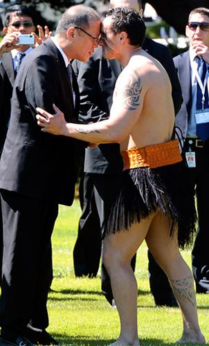 President Aquino receives a hongi welcome, or the touching of noses, from a Maori warrior at an official welcome at the Government House in Wellington, New Zealand yesterday. <b>AP</b>