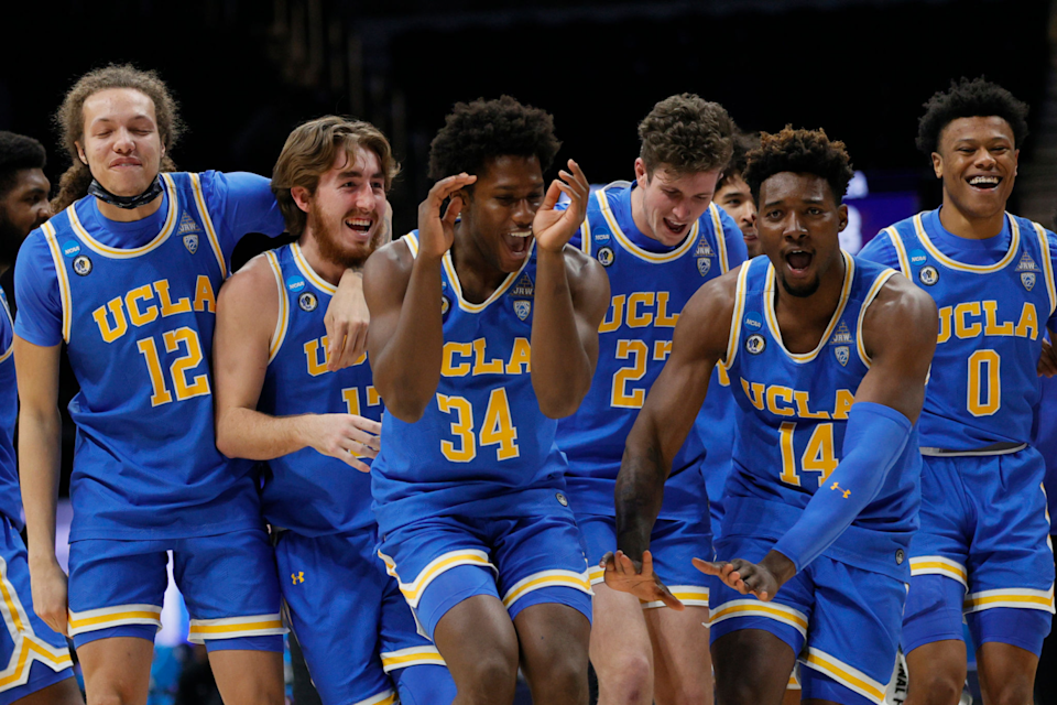 UCLA players celebrate their Sweet 16 victory over Alabama on March 28.