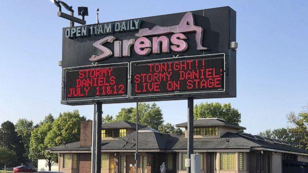 PHOTO: Stormy Daniels' 2018 appearance is promoted on a sign in front of the Sirens strip club in Columbus, Ohio, July 2018. (The Columbus Dispatch/TNS via Newscom, FILE)