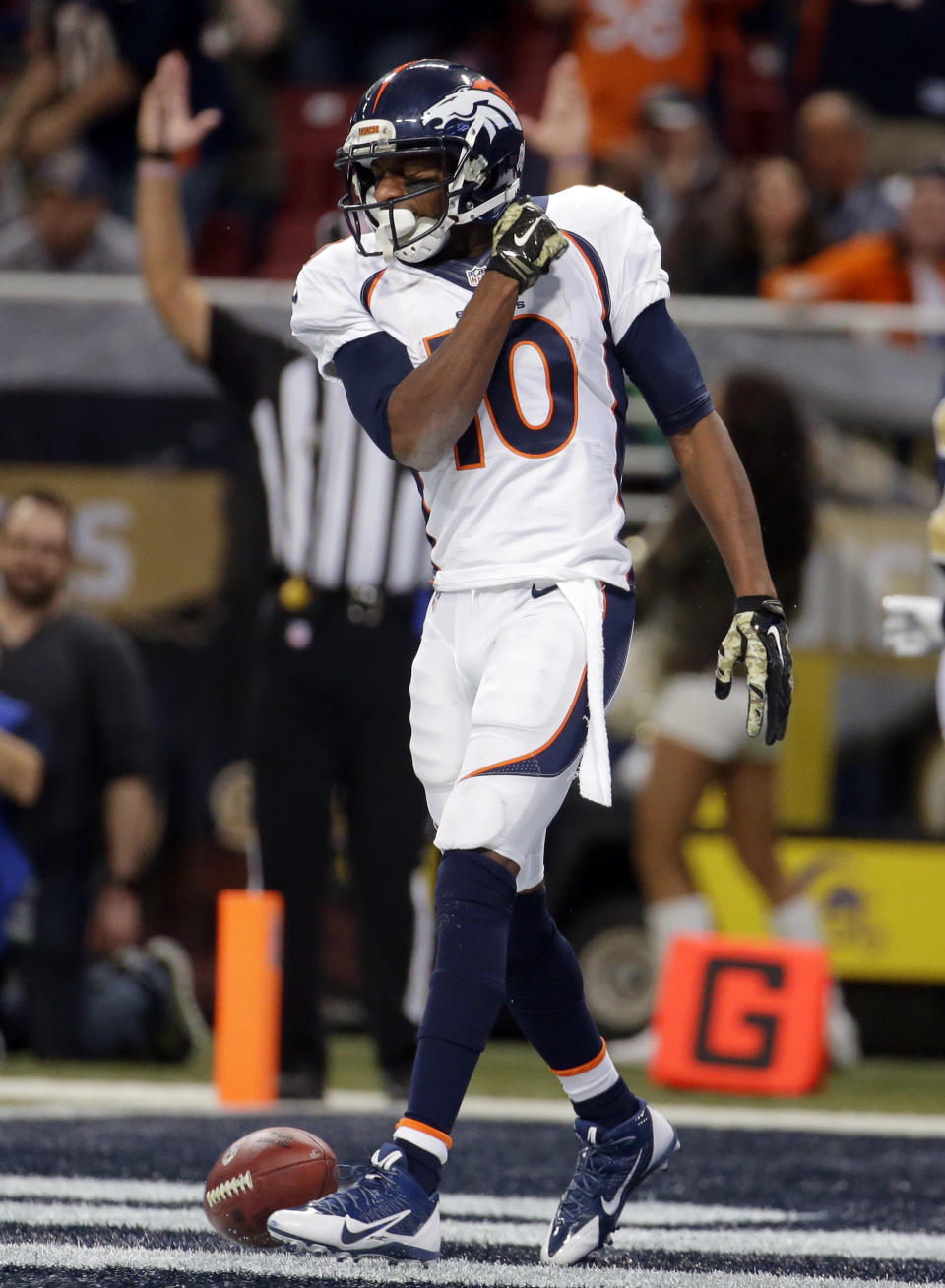 Denver Broncos wide receiver Emmanuel Sanders celebrates after catching a 42-yard pass for a touchdown during the second quarter of an NFL football game against the St. Louis Rams, Sunday, Nov. 16, 2014, in St. Louis. (AP Photo/Charlie Riedel)