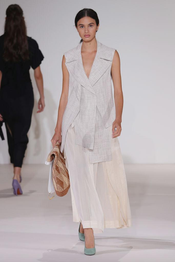 <p>Victoria Beckham also played on the trend this season. Finished with sweet pastel heels, models stepped out in sleeveless blazers. Opt for styles with wide lapels and asymmetric silhouettes for extra style points. <em>[Photo: Getty]</em> </p>