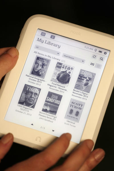 """In this Monday, Oct. 28, 2013 photo, The """"My Library"""" page is selected on Barnes & Noble's new e-reader, Nook GlowLight, during a demonstration in New York. The e-reader is available in its retail stores and online starting Wednesday, Oct. 30, for $119. (AP Photo/Mark Lennihan)"""