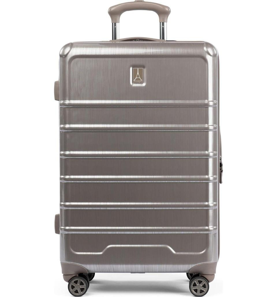 """<p><strong>Travelpro</strong></p><p>nordstromrack.com</p><p><a href=""""https://go.redirectingat.com?id=74968X1596630&url=https%3A%2F%2Fwww.nordstromrack.com%2Fs%2Ftravelpro-rollmaster-lite-24-expandable-medium-checked-hardside-spinner-luggage%2F6107071&sref=https%3A%2F%2Fwww.esquire.com%2Fstyle%2Fmens-accessories%2Fg36675557%2Fluggage-sale-nordstrom%2F"""" rel=""""nofollow noopener"""" target=""""_blank"""" data-ylk=""""slk:Shop Now"""" class=""""link rapid-noclick-resp"""">Shop Now</a></p><p><strong><del>$360</del> $100 (72% off)</strong></p>"""