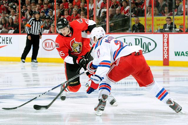 OTTAWA, CANADA - APRIL 18: Erik Karlsson #65 of the Ottawa Senators shoots the puck in front of Ryan McDonagh #27 of the New York Rangers in Game Four of the Eastern Conference Quarterfinals during the 2012 NHL Stanley Cup Playoffs at the Scotiabank Place on April 18, 2012 in Ottawa, Ontario, Canada. (Photo by Richard Wolowicz/Getty Images)