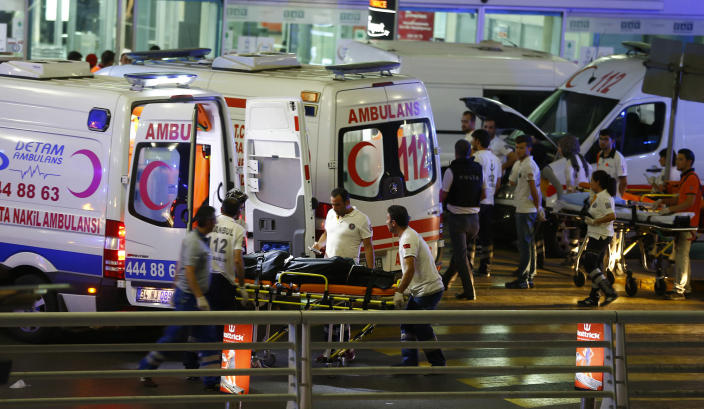 <p>Paramedics push a stretcher at Turkey's largest airport, Istanbul Ataturk, Turkey, following a blast June 28, 2016. (REUTERS/Osman Orsal) </p>