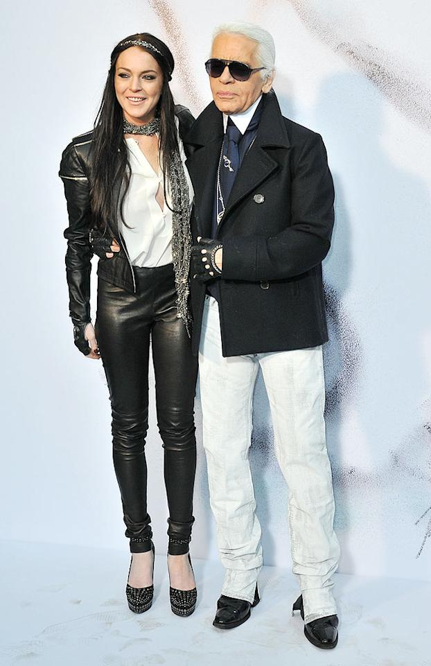 """Despite her fashion flop, Lindsay's friend Karl Lagerfeld stayed by her side. The duo struck a pose at Lagerfeld's Chanel fall/winter show during Paris Fashion Week in 2010. """"She's somebody you want to protect, because she plays dangerously with her own life,"""" the designer told <i>Harper's Bazaar</i> in 2006. Dominique Charriau/<a href=""""http://www.wireimage.com"""" target=""""new"""">WireImage.com</a> - March 9, 2010"""