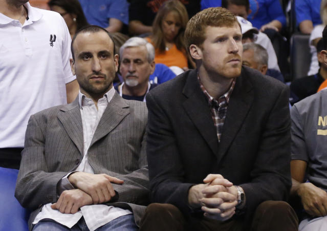 San Antonio Spurs' Manu Ginobili, left, and Matt Bonner, right, sit on the bench during an NBA basketball game against the Oklahoma City Thunder in Oklahoma City, Thursday, April 3, 2014. Oklahoma City won 106-94. (AP Photo/Sue Ogrocki)
