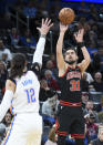 Chicago Bulls guard Thomas Satoranksy (31) shoots the ball over Oklahoma City Thunder guard Steven Adams (12) in the first half of an NBA basketball game, Monday, Dec. 16, 2019, in Oklahoma City. (AP Photo/Kyle Phillips)