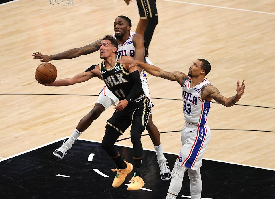 Hawks star Trae Young fights for every inch against the Sixers' defense. (Kevin C. Cox/Getty Images)