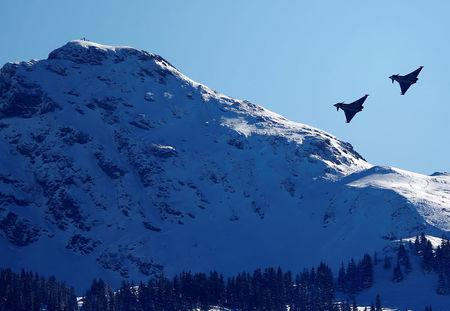 FILE PHOTO: Two Eurofighter Typhoon aircrafts fly over the Streif course during an aerial exhibition before the start of the men's Alpine Skiing World Cup Super G race in Kitzbuehel, Austria, January 22, 2016. REUTERS/Dominic Ebenbichler/File Photo