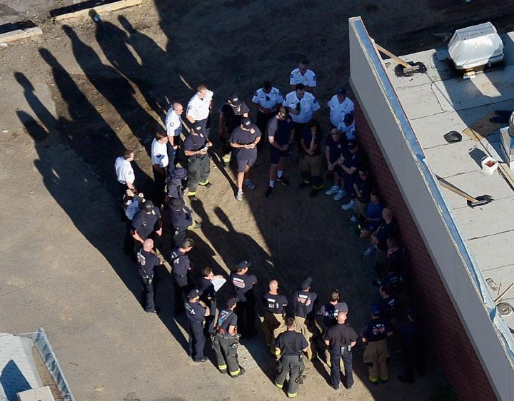 AURORA, CO - JULY 21:  Seen from the air, police and fire fighters have their morning meeting as they surround the booby-trapped apartment of suspect James Holmes after he went on a shooting rampage at nearby Century 16 movie theatre during an early morning screening of the new Batman movie, 'The Dark Knight Rises,' on July 21, 2012 in Aurora, Colorado. According to reports, 12 people have been killed and over 59 injured including 9 in critical condition. Police have the suspect, twenty-four year old James Holmes of North Aurora, in custody.