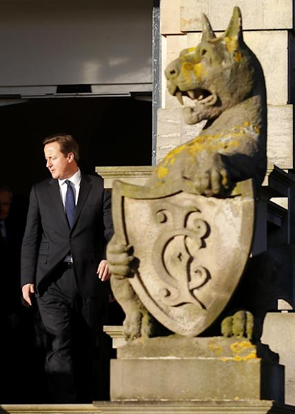 British Prime Minister David Cameron arrives for a press conference at Stormont Castle, Belfast, Northern Ireland, Tuesday, Nov. 20, 2012. The Prime Minister arrived in the province to announce that that the G8 summit will be held in Fermanagh Northern Ireland in June 2013. (AP Photo/Peter Morrison)
