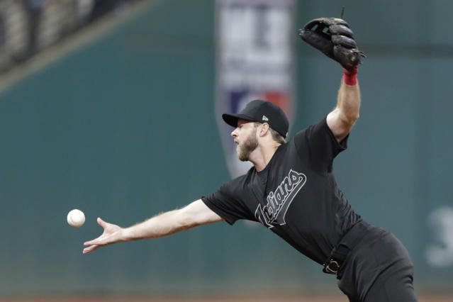 Cleveland Indians' Mike Freeman bobbles a ball hit by Kansas City Royals' Humberto Arteaga in the fifth inning in a baseball game Saturday, Aug. 24, 2019, in Cleveland. Arteaga was safe at first base on the error by Freeman. (AP Photo/Tony Dejak)
