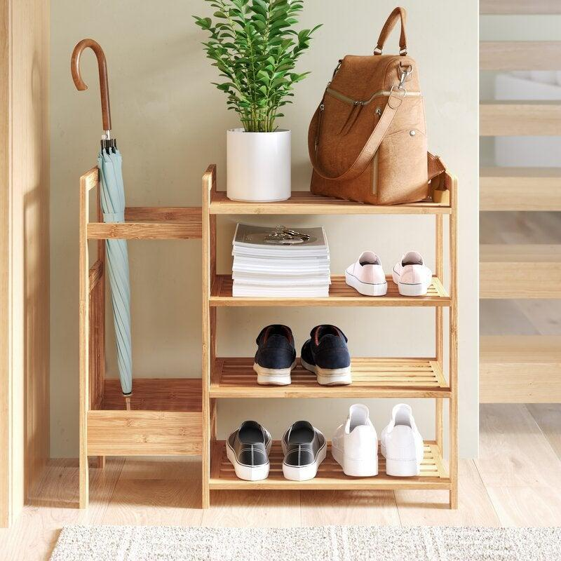 """<h2>47% Off Dotted Line Bamboo Entryway 8 Pair Shoe Rack</h2><br><strong>1,616 reviews and 4.6 out of 5 stars</strong><br>""""Great for small spaces that need organization. Have a wall heater by my back door so getting something larger wasn't optimal. It lines flush with the wall, so no bumping into it. I use the top shelf with a basket and keep our dog's stuff there. Then use the other shelves for my 'outside' shoes. The umbrella holder can also hold winter gear like ice scrapers as well."""" <em>– Wayfair Reviewer</em><br><br><em>Shop <strong><a href=""""https://www.wayfair.com/storage-organization/pdp/dotted-line-bamboo-entryway-8-pair-shoe-rack-w001991740.html"""" rel=""""nofollow noopener"""" target=""""_blank"""" data-ylk=""""slk:Wayfair"""" class=""""link rapid-noclick-resp"""">Wayfair</a></strong></em><br><br><strong>Dotted Line</strong> Bamboo Entryway 8 Pair Shoe Rack, $, available at <a href=""""https://go.skimresources.com/?id=30283X879131&url=https%3A%2F%2Fwww.wayfair.com%2Fstorage-organization%2Fpdp%2Fdotted-line-bamboo-entryway-8-pair-shoe-rack-w001991740.html"""" rel=""""nofollow noopener"""" target=""""_blank"""" data-ylk=""""slk:Wayfair"""" class=""""link rapid-noclick-resp"""">Wayfair</a>"""
