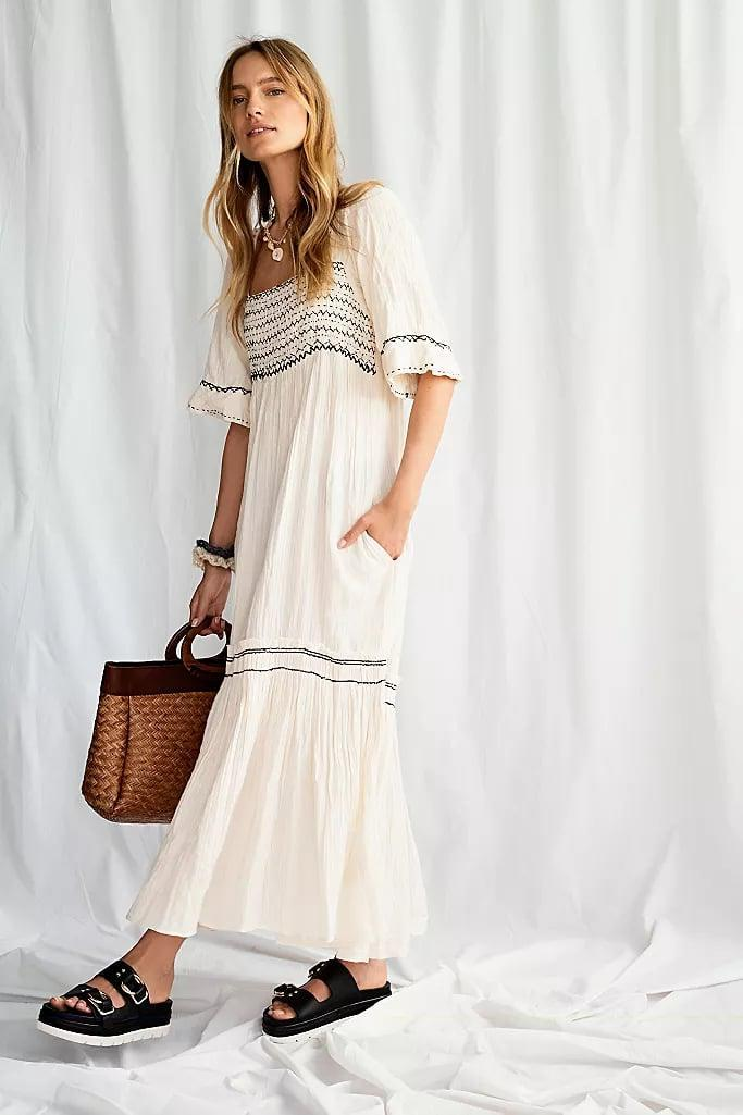 "<p>This <a href=""https://www.popsugar.com/buy/Free-People-Im-One-Maxi-Dress-576331?p_name=Free%20People%20I%27m%20The%20One%20Maxi%20Dress&retailer=freepeople.com&pid=576331&price=168&evar1=fab%3Aus&evar9=47495570&evar98=https%3A%2F%2Fwww.popsugar.com%2Fphoto-gallery%2F47495570%2Fimage%2F47496463%2FFree-People-Im-One-Maxi-Dress&list1=shopping%2Cdresses%2Csummer%20fashion%2Cfashion%20shopping&prop13=api&pdata=1"" class=""link rapid-noclick-resp"" rel=""nofollow noopener"" target=""_blank"" data-ylk=""slk:Free People I'm The One Maxi Dress"">Free People I'm The One Maxi Dress</a> ($168) comes in a few colors.</p>"