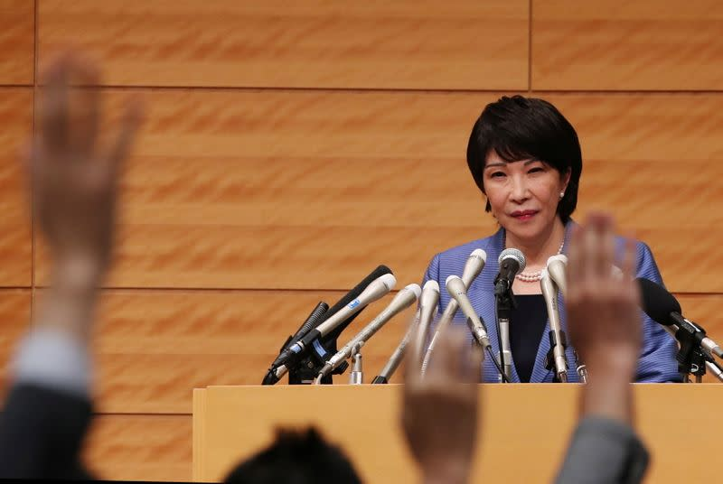 Japanese lawmaker Sanae Takaichi looks at members of the media at a news conference in Tokyo
