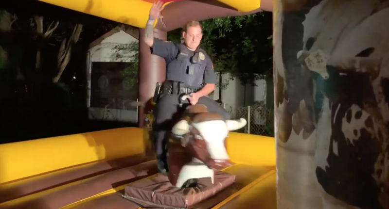 An officer with Kilgore Police Department in Texas asked party-goers to keep the noise down, but not before riding a mechanical bull in the house party's yard. (Photo: Facebook)