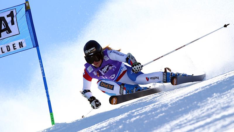 Switzerland's Lara Gut competes on her way to set the fastest time, during the first run of an Alpine ski, women's World Cup giant slalom, in Soelden, Austria, Saturday, Oct. 26, 2013. (AP Photo/Alessandro Trovati)