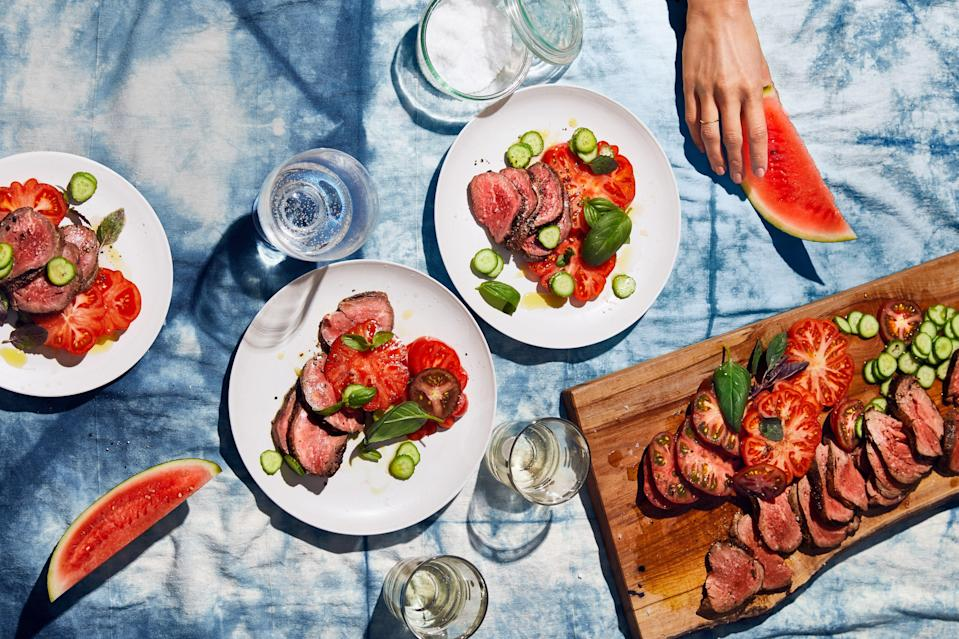 """This recipe asks you to create two temperature zones on your grill, which is 1) <a href=""""https://www.epicurious.com/expert-advice/grill-bbq-set-up-two-zone-direct-indirect-heat-article?mbid=synd_yahoo_rss"""" rel=""""nofollow noopener"""" target=""""_blank"""" data-ylk=""""slk:really easy"""" class=""""link rapid-noclick-resp"""">really easy</a> and 2) well worth doing for this amazing beef tenderloin, which you'll sear first over high heat before finishing it on the cooler side. The result? A perfect medium-rare cut. <a href=""""https://www.epicurious.com/recipes/food/views/cold-beef-tenderloin-with-tomatoes-and-cucumbers?mbid=synd_yahoo_rss"""" rel=""""nofollow noopener"""" target=""""_blank"""" data-ylk=""""slk:See recipe."""" class=""""link rapid-noclick-resp"""">See recipe.</a>"""