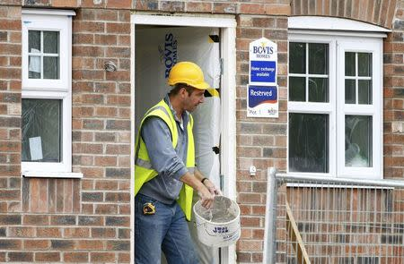 FILE PHOTO: A builder works at a Bovis homes housing development near Bolton, Britain, July 9, 2008. REUTERS/Phil Noble/File Photo
