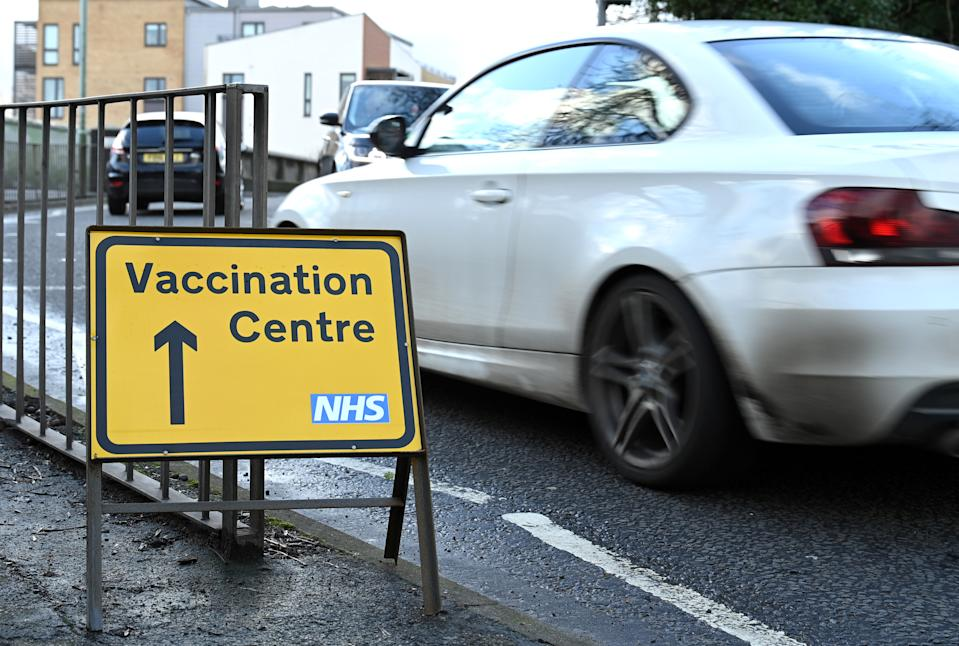 BOREHAMWOOD, ENGLAND - JANUARY 29: A road sign directing recipients of the covid vaccine to the Allum Lane vaccination centre during the third coronavirus lockdown on January 29, 2021 in Borehamwood, England. With a surge of covid-19 cases fuelled partly by a more infectious variant of the virus, British leaders have reimposed nationwide lockdown measures across England through at least mid February. (Photo by Karwai Tang/Getty Images)
