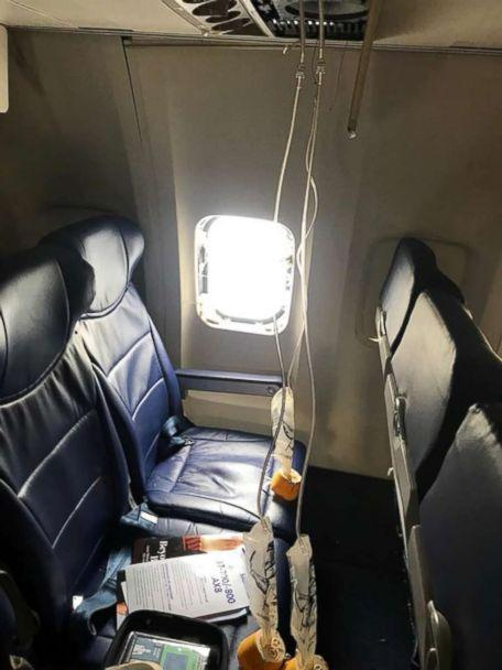 PHOTO: Oxygen masks and a blown out window are seen from inside a Southwest Airlines plane after an emergency landing at the Philadelphia airport, April 17, 2018. (Marty Martinez)